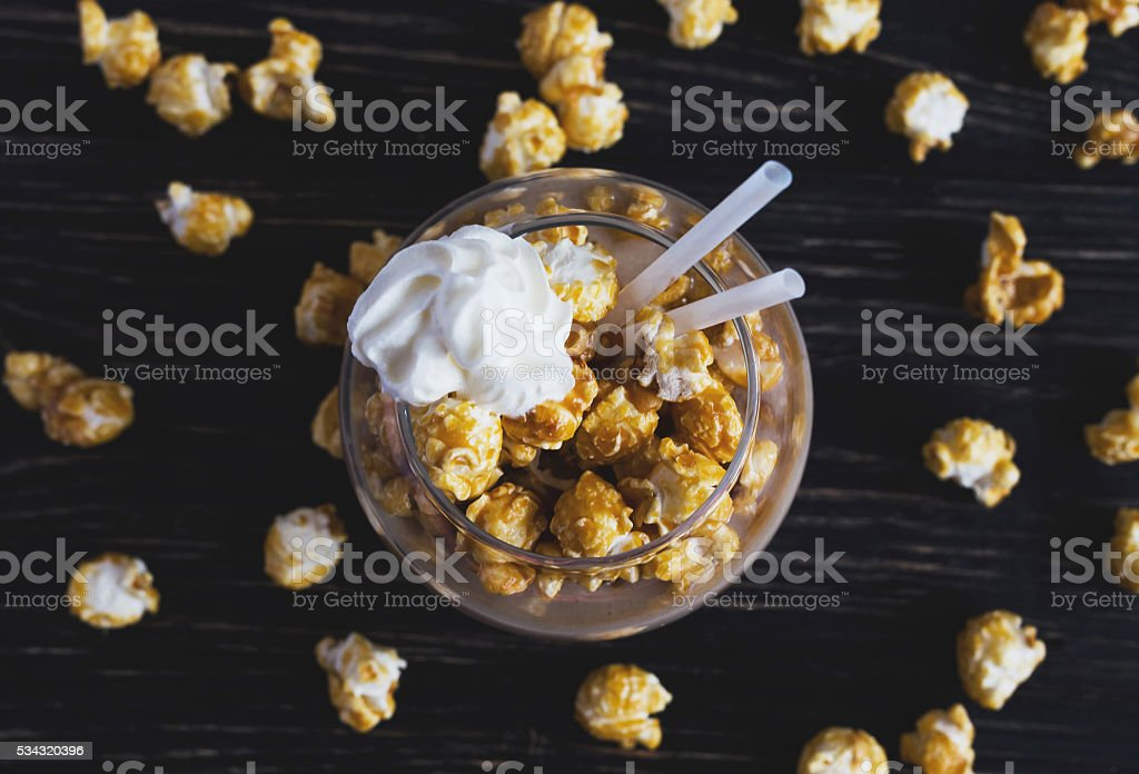 Cup of cacao with caramel popcorn stock photo