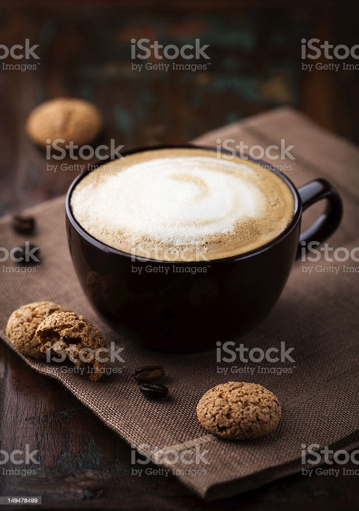 Cup of cafe au lait with biscotti royalty-free stock photo
