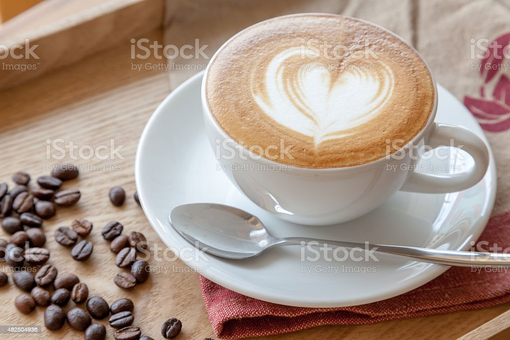 Cup of cafe latte and coffee beans - Royalty-free 2015 Stock Photo