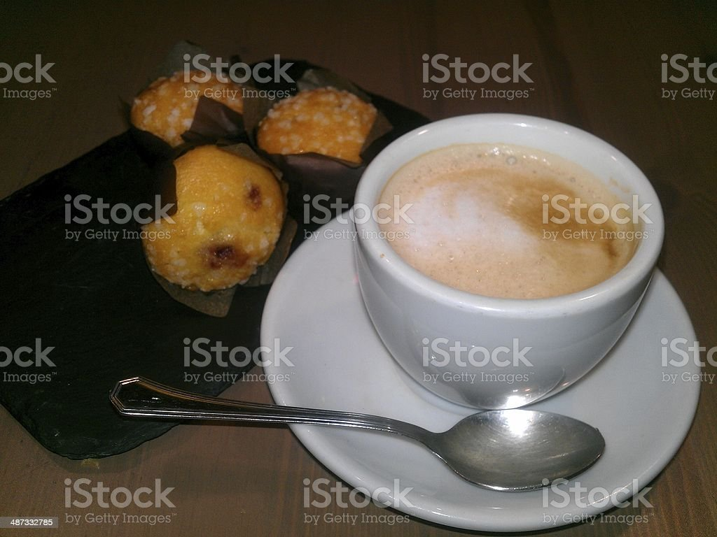 Cup of cappuccino and mufin royalty-free stock photo