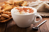Cup of cappuccino coffee on wooden table