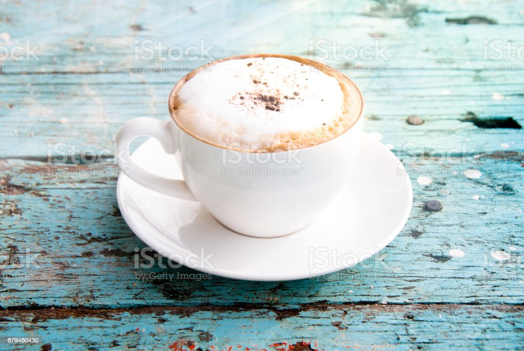 A cup of Cappuccino coffee under sunshade royalty-free stock photo