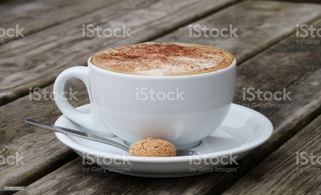 Cup of cappuccino coffee with amaretti biscuit stock photo