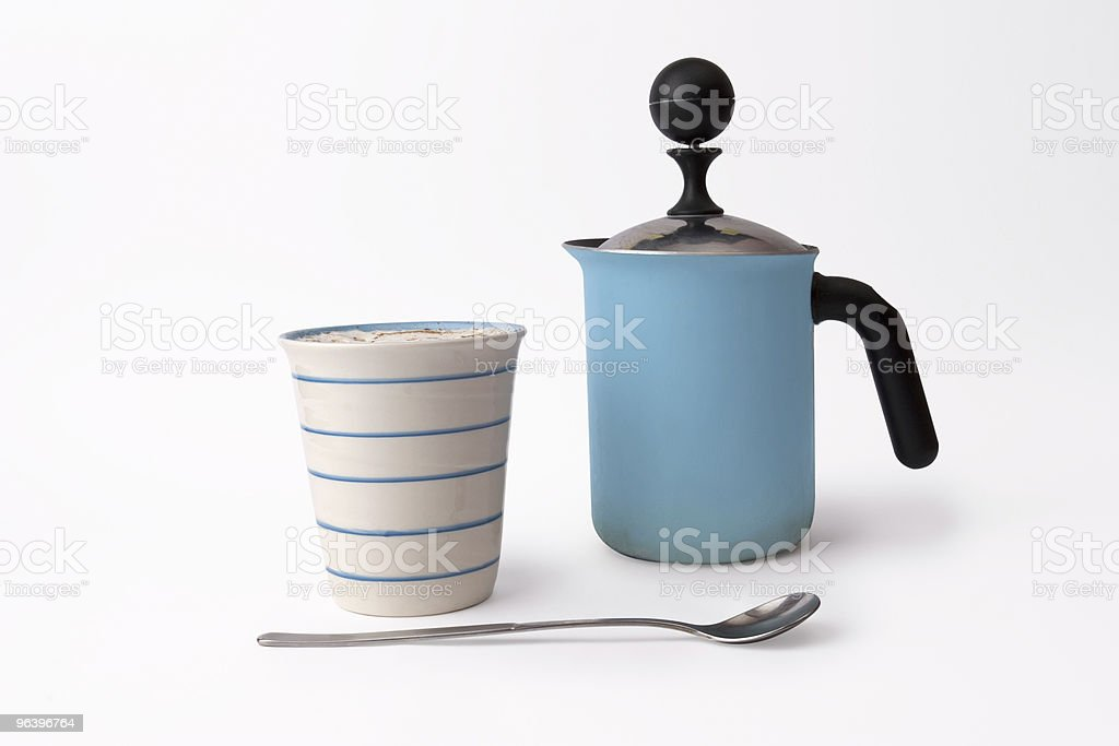 cup of cappuccino, long spoon and coffee kettle royalty-free stock photo