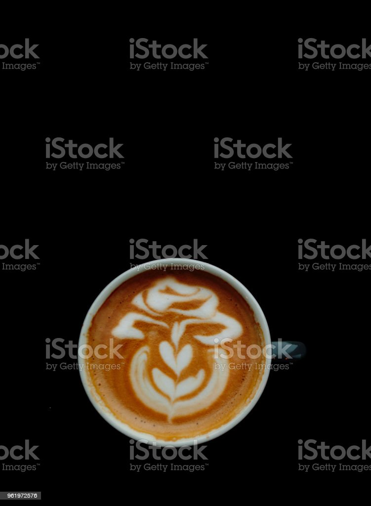 A cup of cappuccino on black background. stock photo
