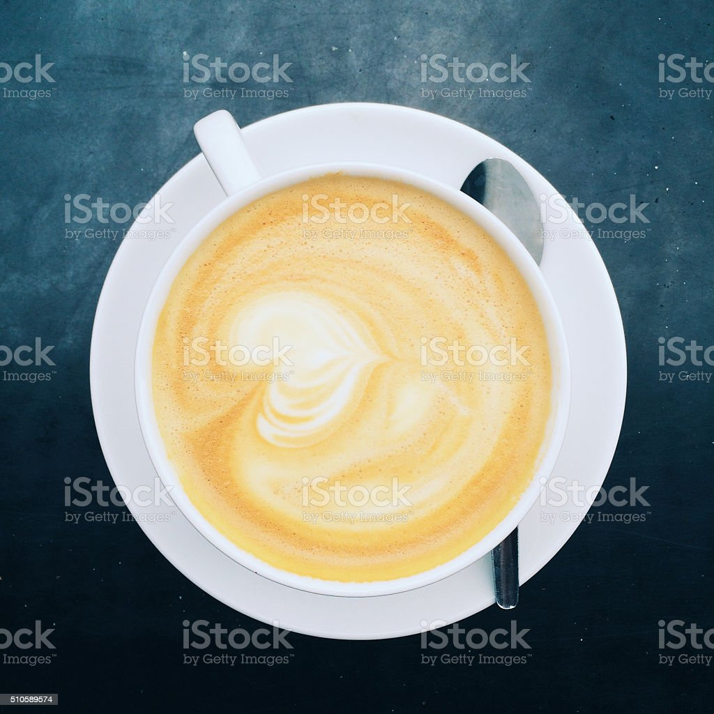Cup of cappuccino on table stock photo