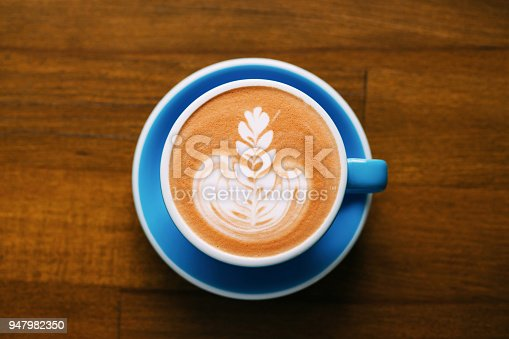 istock A cup of cappuccino on table. 947982350