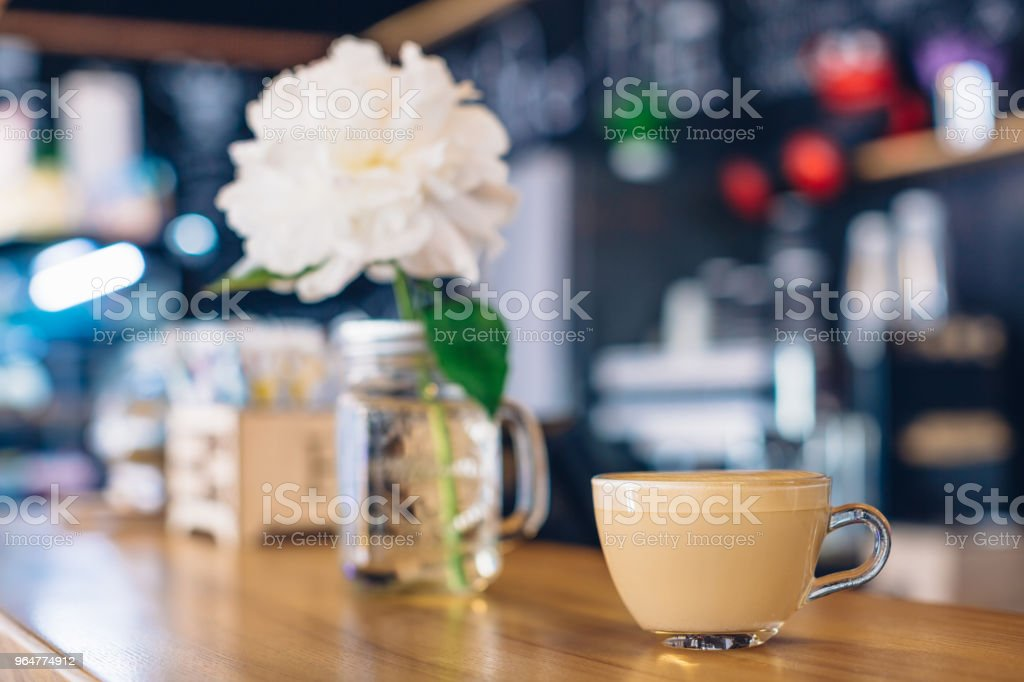 A cup of cappuccino on the bar counter in a cafe royalty-free stock photo