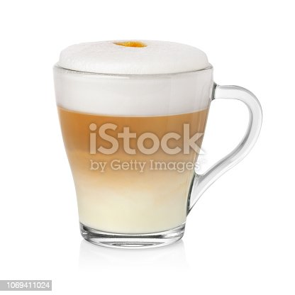 Transparent cup with cappuccino coffe and milk foam isolated on white background