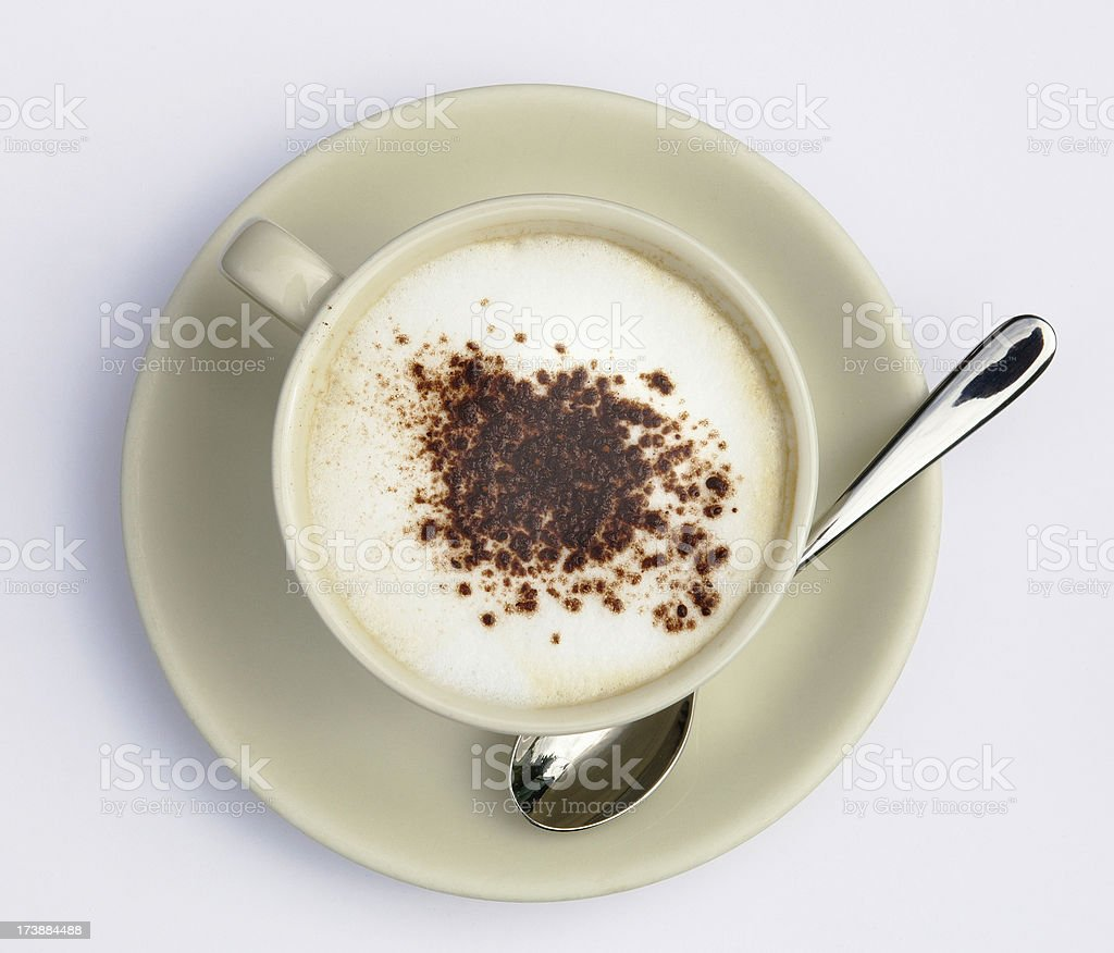 Cup of cappuccino with cacao on white background, above view royalty-free stock photo
