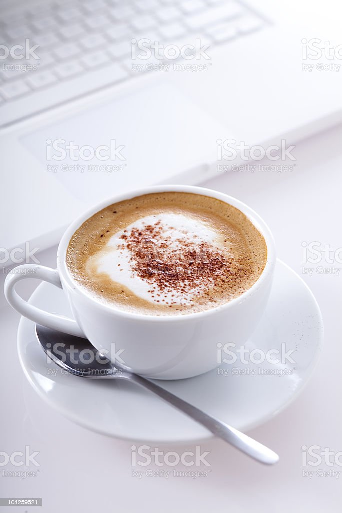 cup of cappuccino with laptop royalty-free stock photo