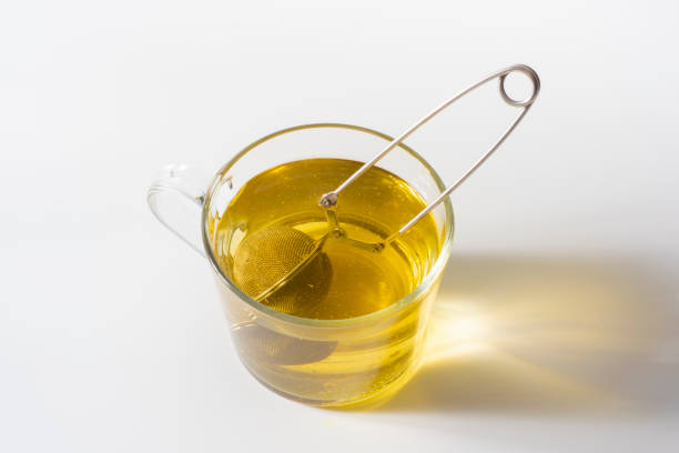 A cup of Chamomile tea in a clear glass mug stock photo