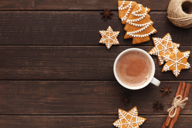 Cup of cocoa with gingerbread cookies on table Christmas composition. Cup of cocoa, gingerbread cookies on vintage wooden table, top view, copy space hot chocolate stock pictures, royalty-free photos & images