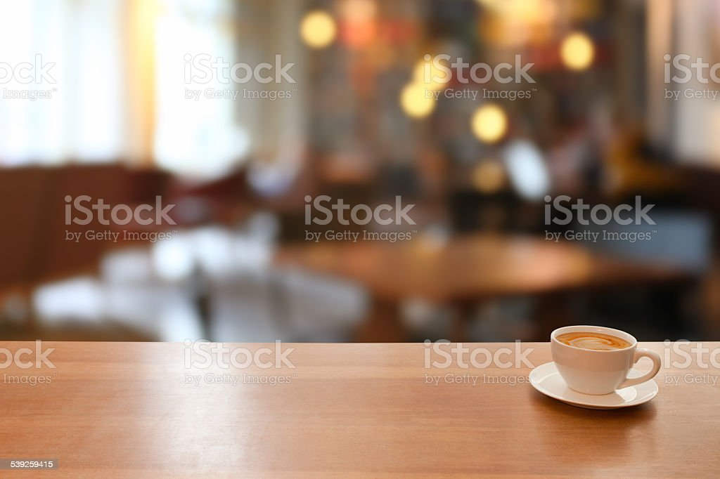 Cup of coffe on table, day, cafeteria defocused background stock photo