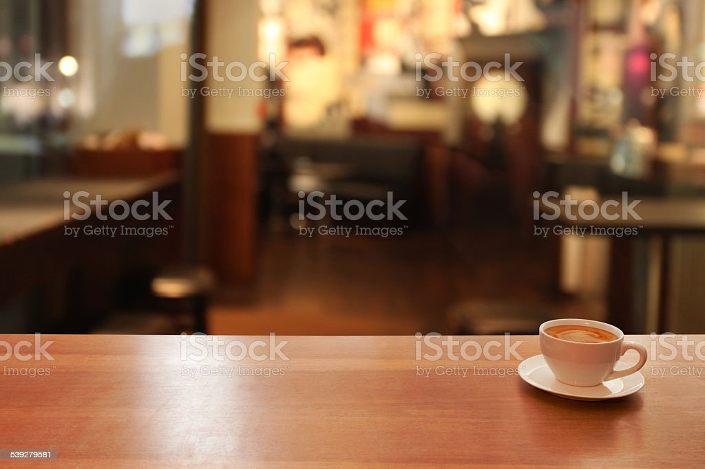Cup of coffe on table, night, restaurant defocused background stock photo