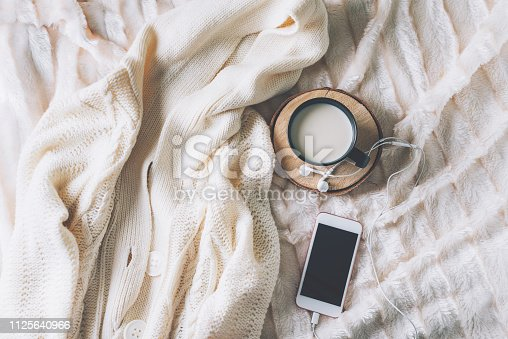 istock Cup of coffe with phone and headphones 1125640966