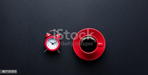 istock cup of coffee and alarm clock 807101510