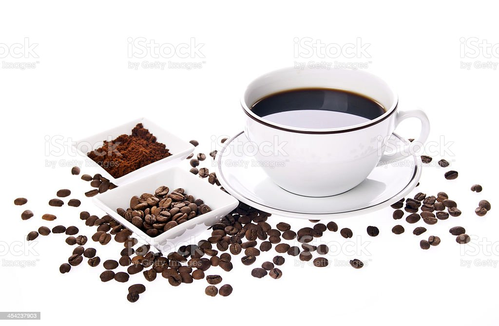 cup of coffee and beans around it royalty-free stock photo