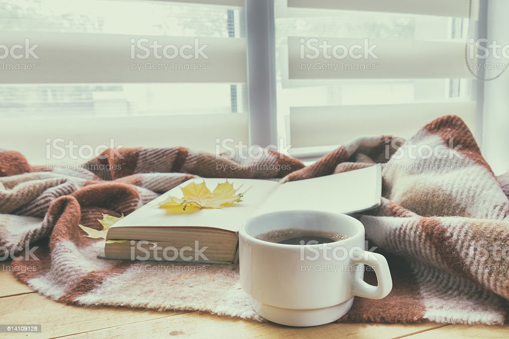 Cup of coffee and book with autumn yellow stock photo