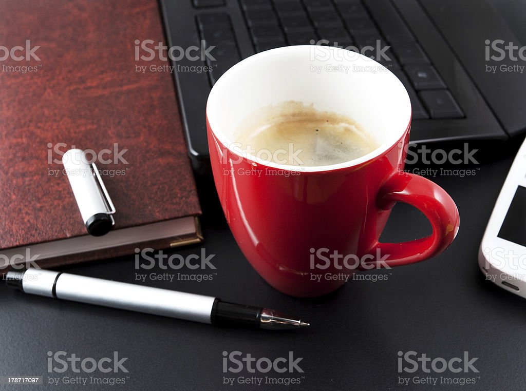 cup of coffee and business objects royalty-free stock photo
