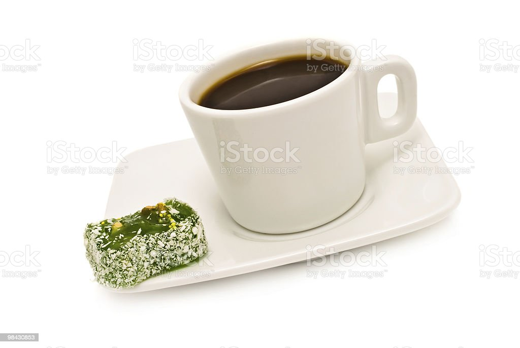 cup of coffee and candy on a saucer royalty-free stock photo