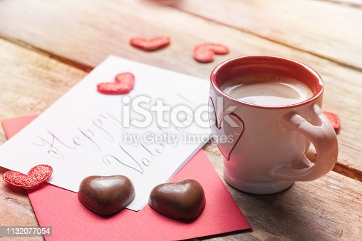 istock Cup of coffee and chocolate hearts 1132077054