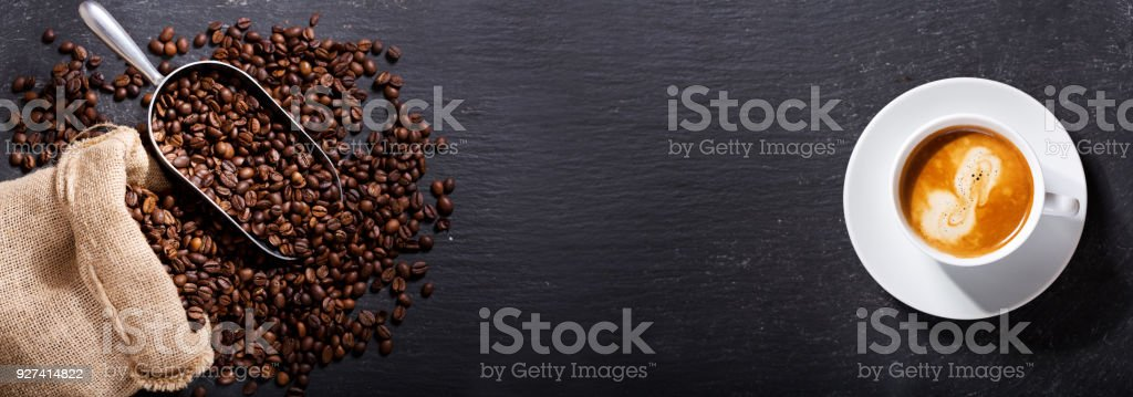 cup of coffee and coffee beans in a sack, top view stock photo