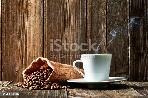 istock Cup of coffee and coffee beans 494090304