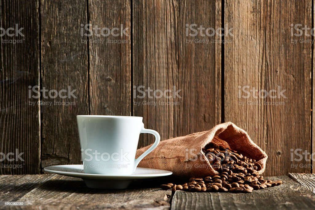 Cup of coffee and coffee beans stock photo