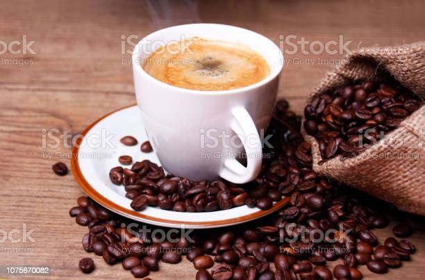 Cup of coffee and coffee of beans picture id1075670082?b=1&k=6&m=1075670082&s=612x612&h=pym4xhupyi9bobifwnbltvuqieem0bbfbwdvc2cz8xc=