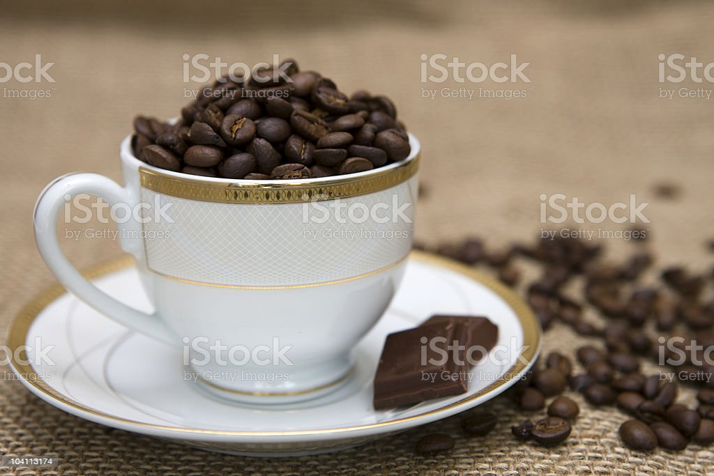 Cup of coffee and corn on sacking stock photo