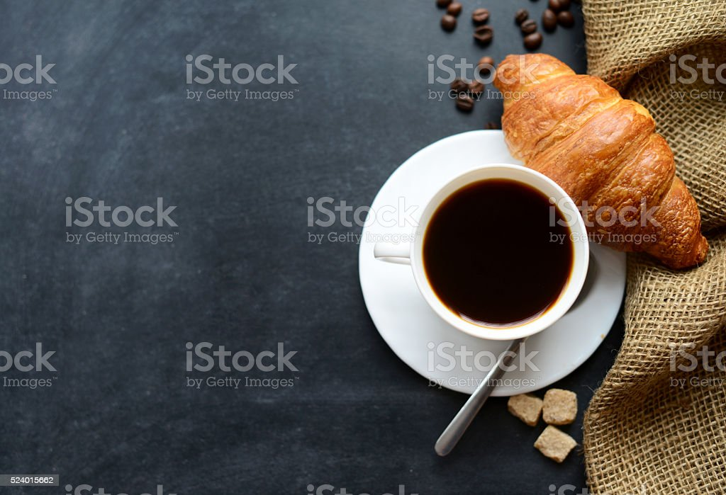 cup of coffee and croissants on black background stock photo