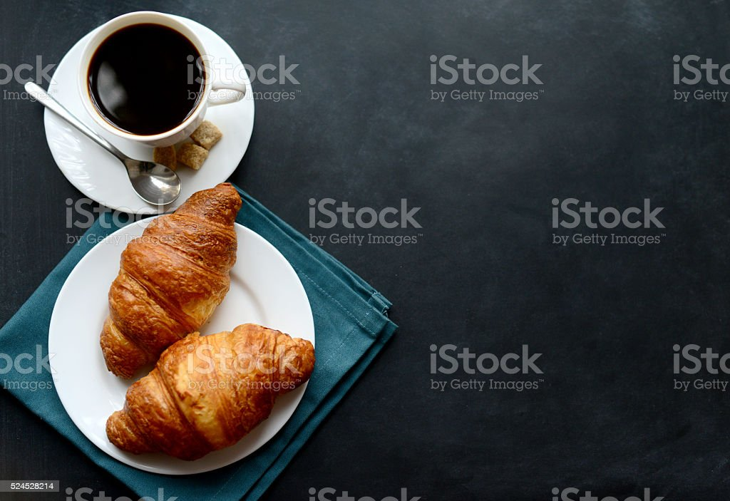 cup of coffee and croissants on black background bildbanksfoto