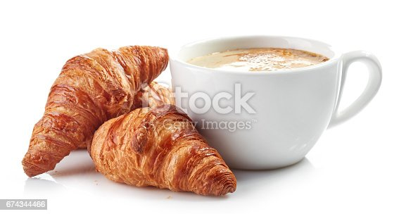 cup of coffee and croissants isolated on white background