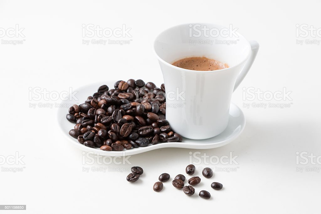 Cup of coffee and fresh roasted organic Coffee beans stock photo