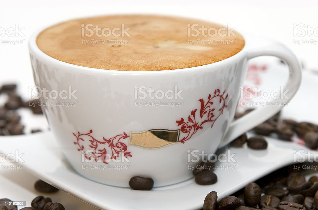 Cup of coffee and grains over white royalty-free stock photo