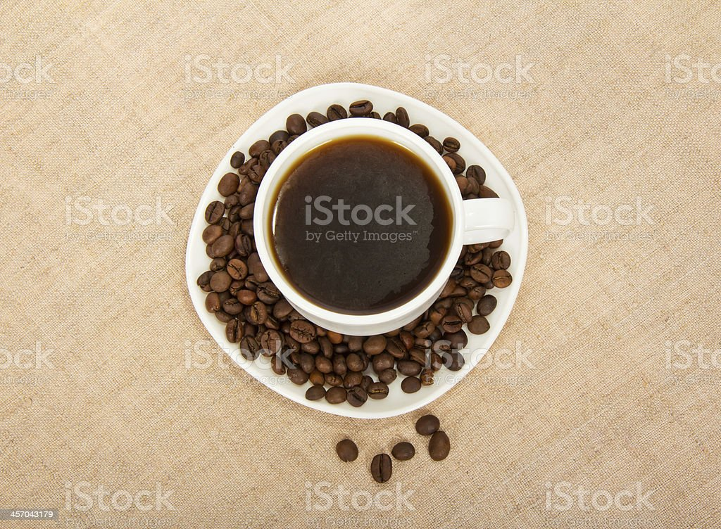 Cup of coffee and grains royalty-free stock photo