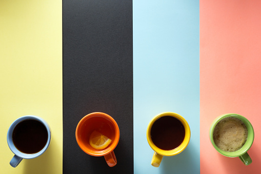 cup of coffee and ingredients at abstract background