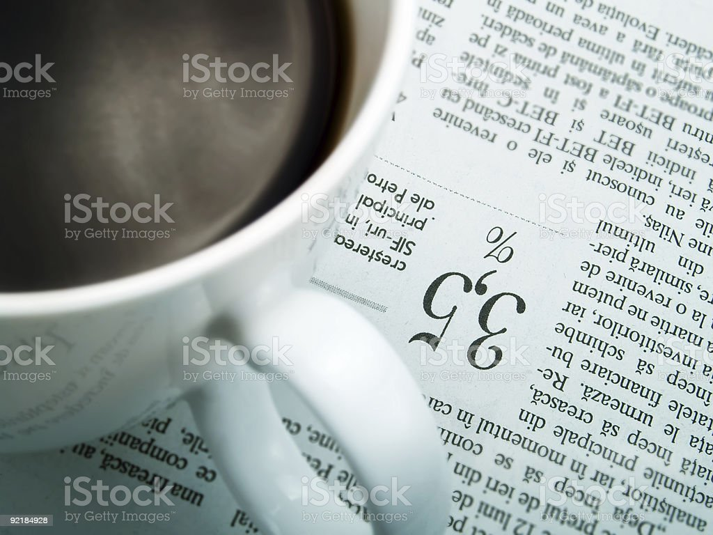 Cup of coffee and newspaper royalty-free stock photo