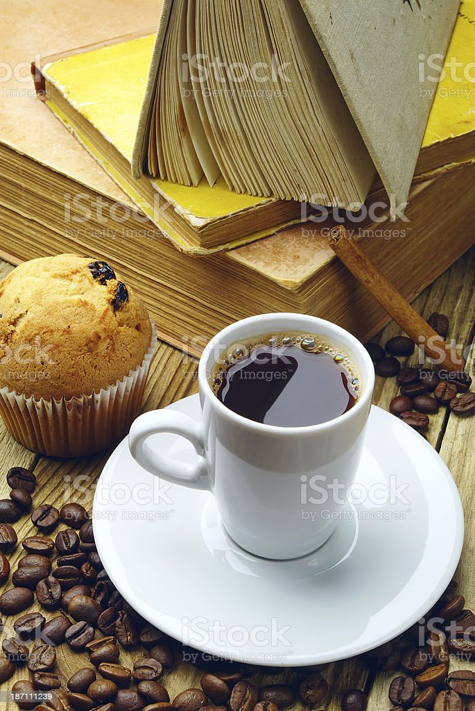 Cup of coffee and old books royalty-free stock photo