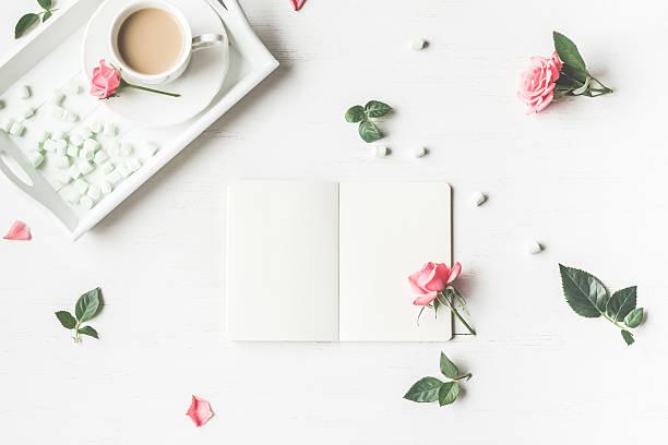 cup of coffee and rose flowers. flat lay, top view - folha de caderno imagens e fotografias de stock