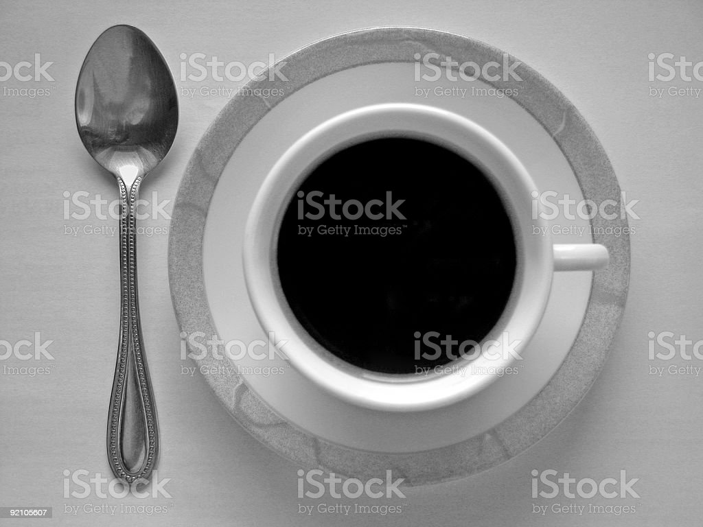 Cup of coffee and spoon stock photo