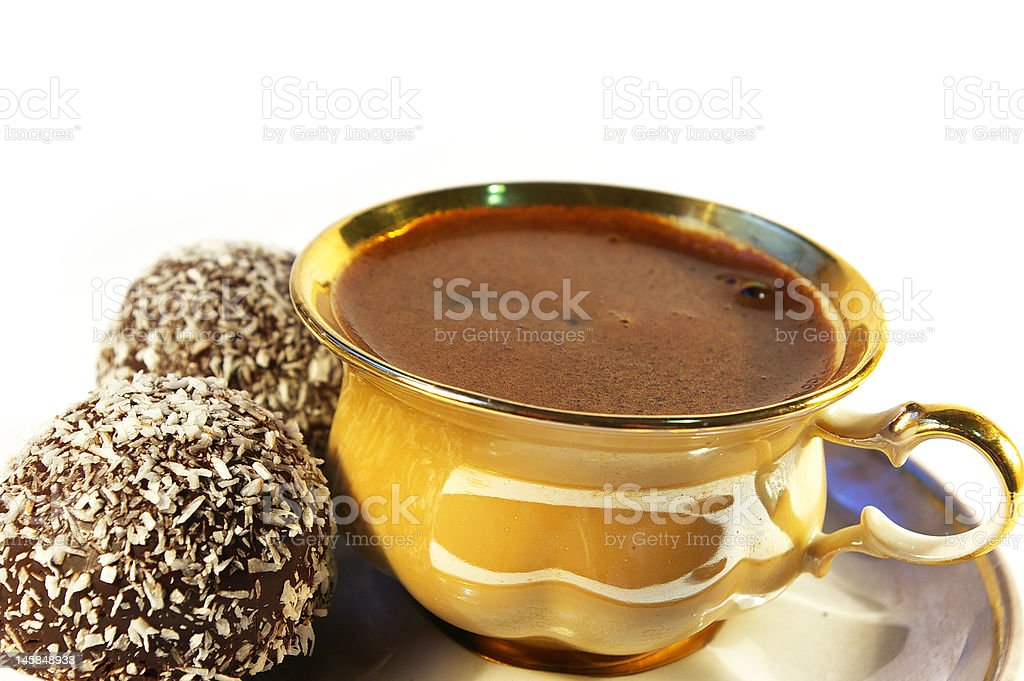Cup of coffee and sweet with a coco stock photo