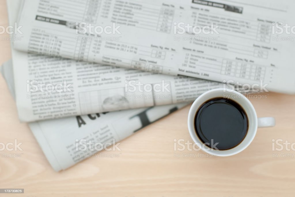Cup of coffee and the newspapers royalty-free stock photo