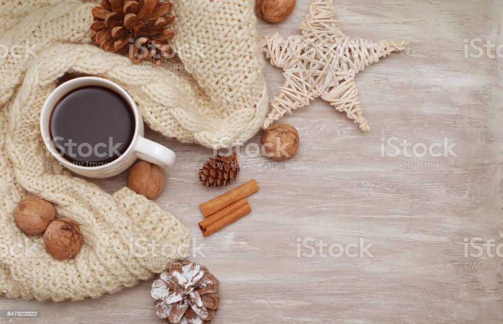 Cup of coffee and warm knitted sweaters. stock photo