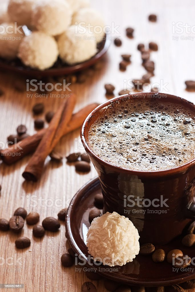 cup of coffee and white chocolate truffles on table royalty-free stock photo