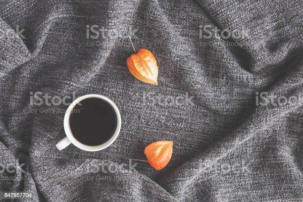 Photo of Cup of coffee, autumn flowers. Flat lay, top view