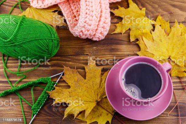 Cup of coffee ball of yarn knitting knitted scarf and yellow maple picture id1153379174?b=1&k=6&m=1153379174&s=612x612&h=vfk8fudskji 6kvy3iyxr7d74c2zknofhtftpzh qlq=