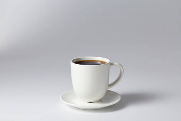 Cтоковое фото Cup of coffee black on bright gray background