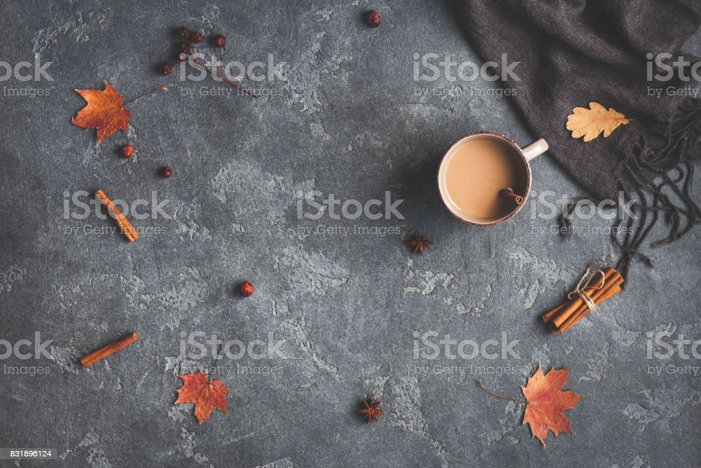 Cup of coffee, blanket, autumn leaves. Flat lay, top view stock photo